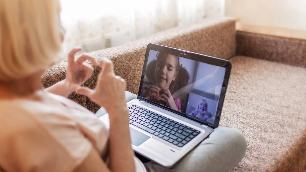grandmother on video call with granddaughter