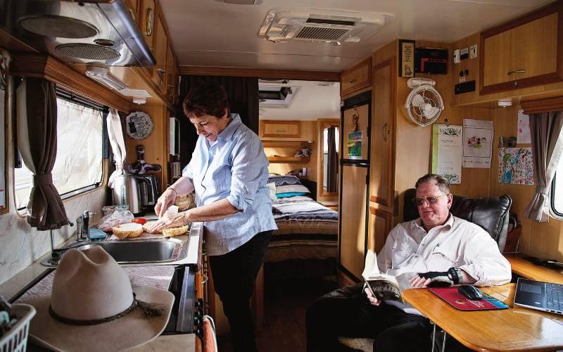 Judy and Earle prepare a meal inside their caravan