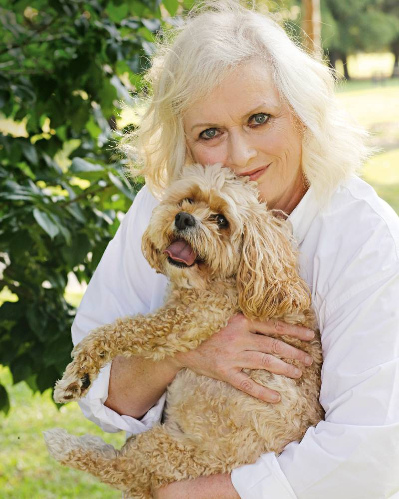 Jill Baker with her cavoodle Harry, the dog she was persuaded to take into her home after losing her husband and battling cancer.