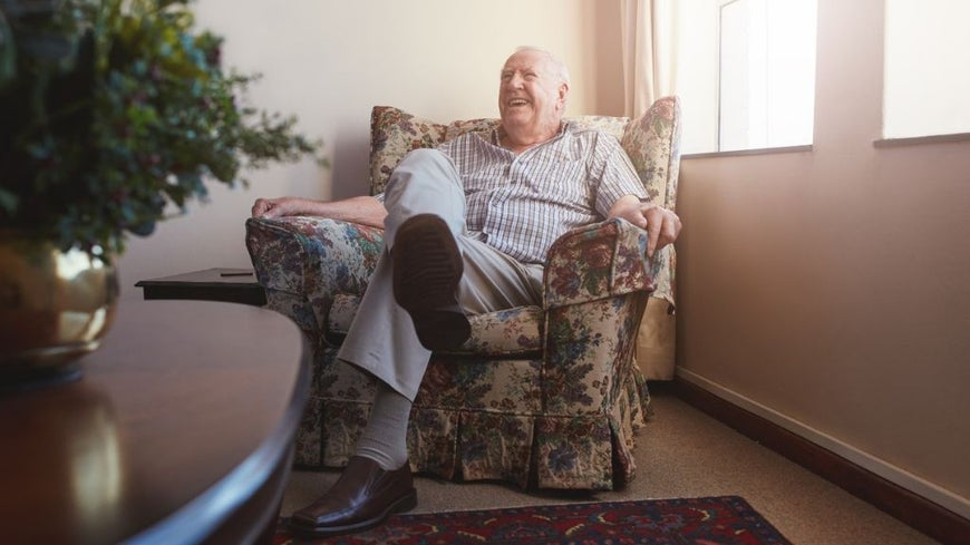 man sitting on couch at home
