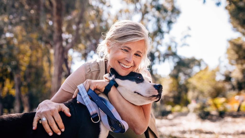 woman hugging older dog