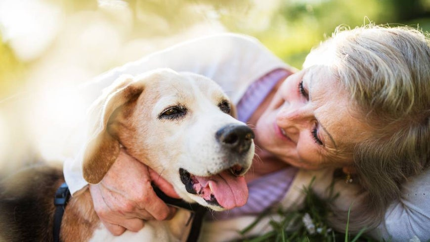 senior woman with dog outdoors