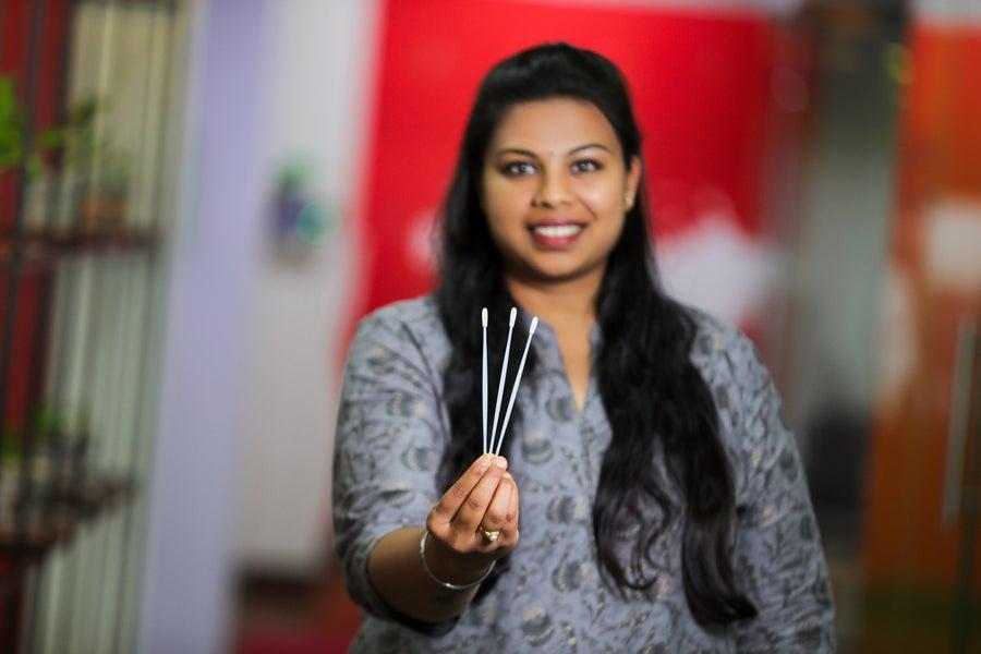 Anusha holding the swabs