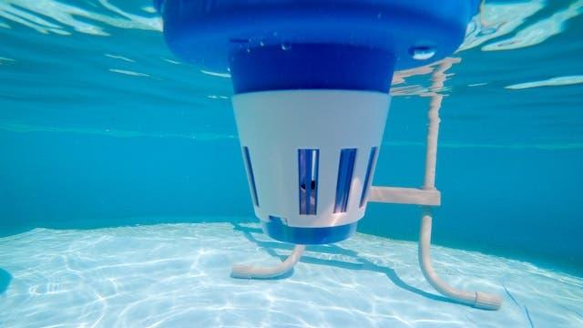 Floating pool tablet dispenser in pool