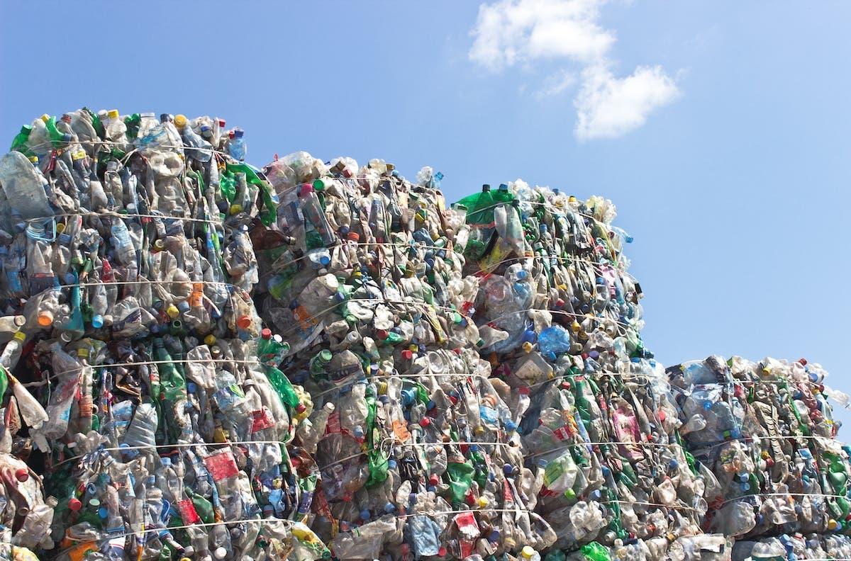 Piles of big plastic waste compressed in big blocks