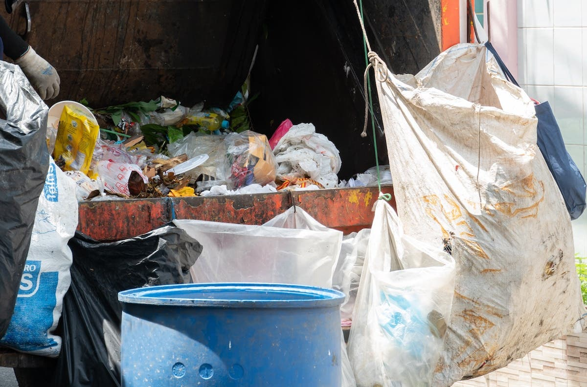 Mixture of household waste in bags and bins