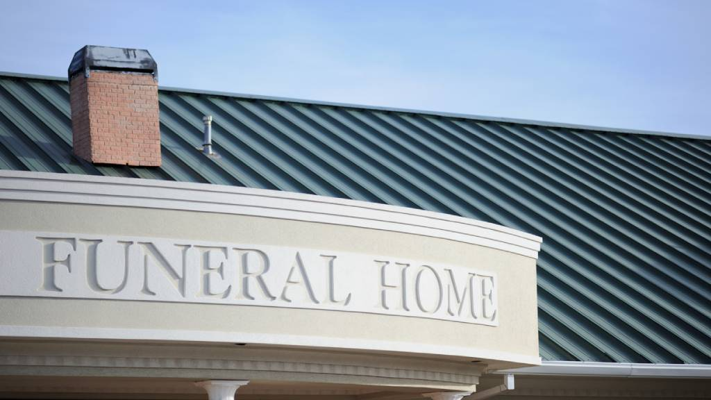 Exterior of a funeral home with carved lettering