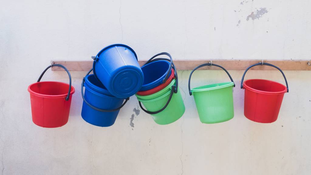 colourful buckets hanging on wall