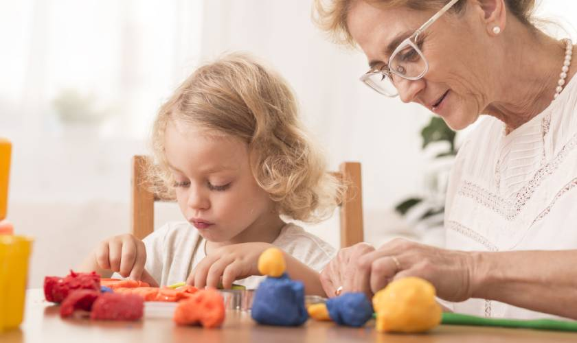 granddaughter and grandmother playing with playdough