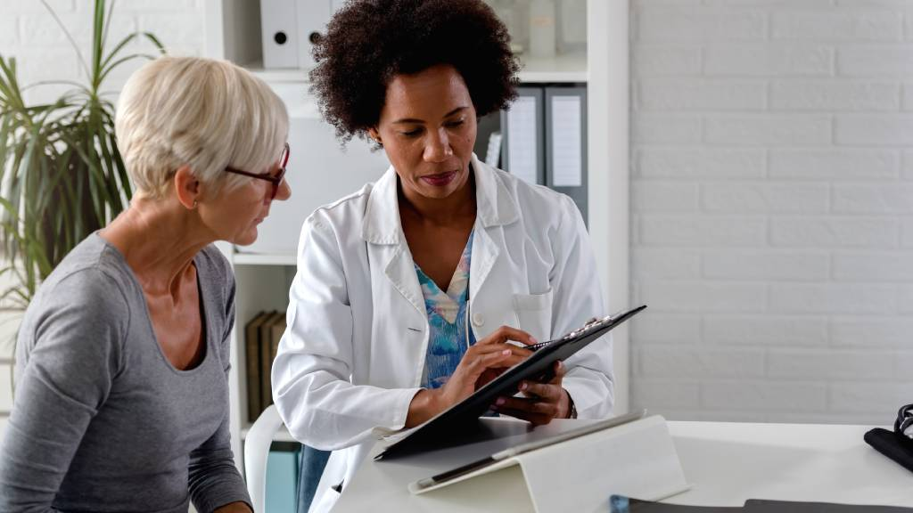 older woman discussing medical results with doctor