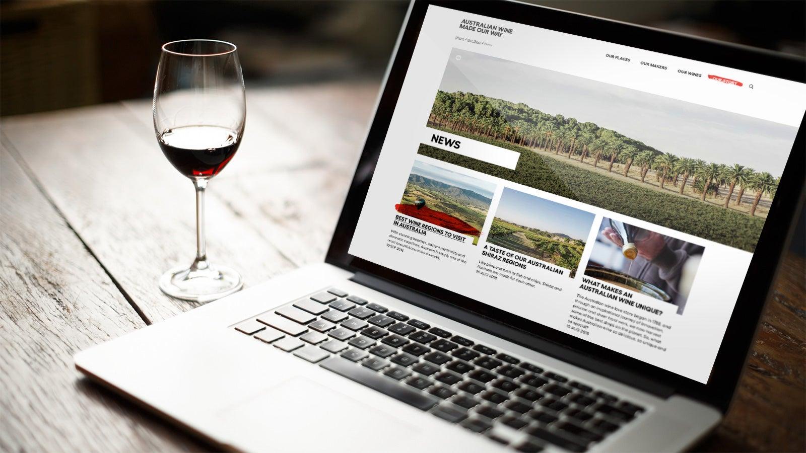 Australian Wine   website open on laptop next o a glass of red wine   Devotion
