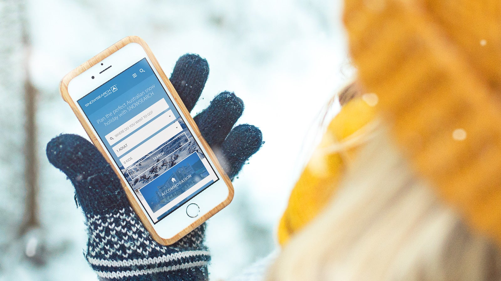 Snowsearch | website on mobile held by someone in the snow wearing a glove | Devotion